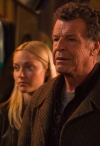 "FRINGE: Etta (guest star Georgina Haig, L) and Walter (John Noble, R) search through an underground market for Olivia in the FRINGE Season Five premiere episode ""Transilience Thought Unifier Model-11"" airing Friday, Sept. 28 (9:00-10:00 PM ET/PT) on FOX. ©2012 Fox Broadcasting Co. CR: Liane Hentscher/FOX"