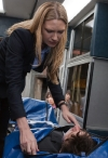 """FRINGE: Olivia (Anna Torv) inspects a victim in the FRINGE Season Four premiere episode """"Neither Here Nor There"""" airing Friday, Sept. 23 (9:00-10:00 PM ET/PT) on FOX. ©2011 Fox Broadcasting Co. CR: Liane Hentscher/FOX"""